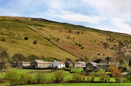 wharfedale: A  view of Buckden, a picturesque village in the rolling countryside of Wharfedale in the Yorkshire Dales, England, on a sunny spring day  Stock Photo