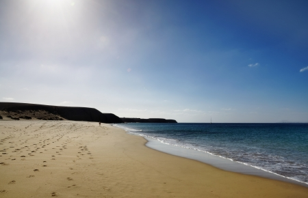 Deserted sandy beach with footprints  Playa de Mujeres beach on Lanzarote, in the Spanish Canary Islands  Stock Photo - 19972242