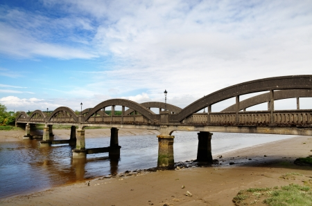 A summer day in Kirkcudbright, Scotland, showing the five span bridge constructed in 1926 traversing the River Dee Stock Photo - 20299003
