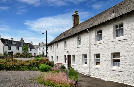 Picturesque view of a row of white painted cottages, in Kirkcudbright, Dumfries and Galloway, Scotland, on a lovely summer day Stock Photo - 20299064