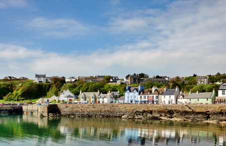 colourfully: Row of colourfully painted houses lining Portpatrick harbour in southwest Scotland, on a calm and beautiful summers day