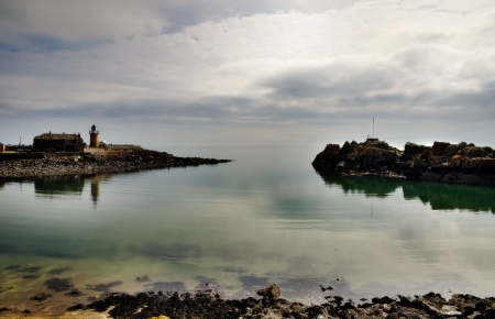 View of Portpatrick harbour in southwest Scotland, looking out to sea on a tranquil day in summer Stock Photo - 20502885