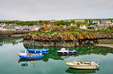 View of colourful boats bobbing on the tranquil waters of Portpatrick harbour, southwest Scotland, on a summer day Stock Photo - 20884904