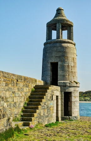View of the lighthouse and stone steps at Port Logan, Dumfries and Galloway, on a bright sunny day Stock Photo - 20884907