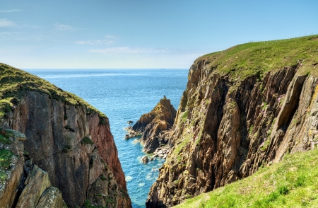 View of the rugged cliffs and sea on the Mull of Galloway, South West Scotland on a glorious summer day Stock Photo - 21014025