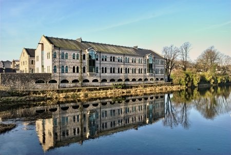 View of offices reflected in the waters of the River Kent in Kendal, Cumbria, on a crisp winter morning Stock Photo - 21842379