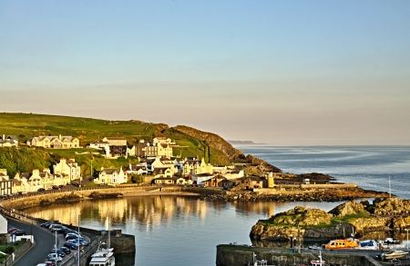Sweeping view of Partpatrick Harbour in Dumfries and Galloway, Scotland as dusk falls on a summers day