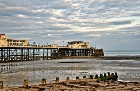 Worthing Pier, a Victorian construction in West Sussex built in 1862, with shingle beach and  wooden groynes Stock Photo - 21933962