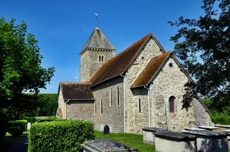 additions: St Andrews,a Saxon church with later additions in the village of Bishopstone, East Sussex Stock Photo