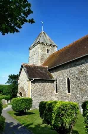 Close up view of St Andrews,a Saxon church in the village of Bishopstone, East Sussex Stock Photo - 22126451