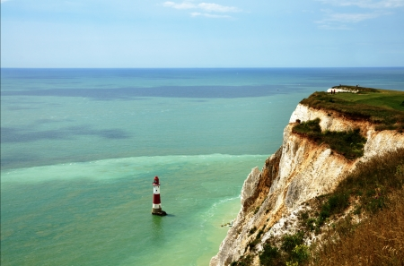 Chalk cliffs, sea, and a lighthouse at Beachy Head, East Sussex, England Stock Photo - 23086269