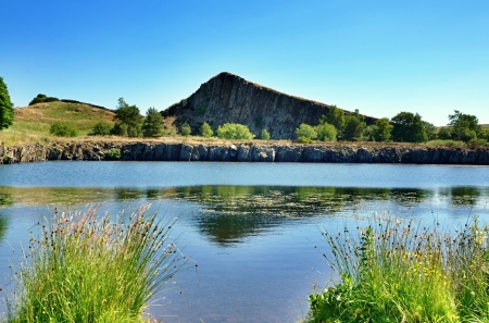 Calm waters of Cawfield Quarry by Hadrians Wall, Northumberland,on a summer day photo