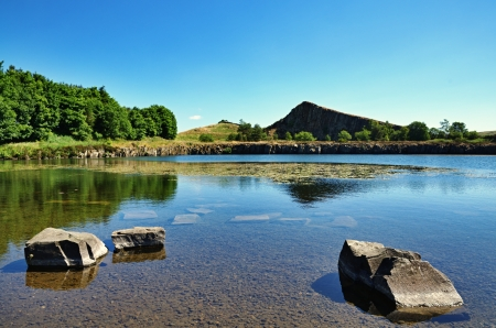 Cawfield Quarry by Hadrians Wall, Northumberland, with rocks in the foreground on a summer day Stock Photo - 23086284
