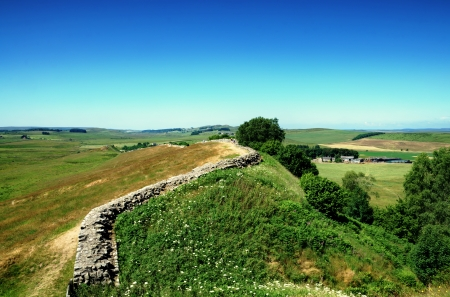 undulating: View of Hadrians Wall in Northumberland, a Roman structure winding across undulating countryside