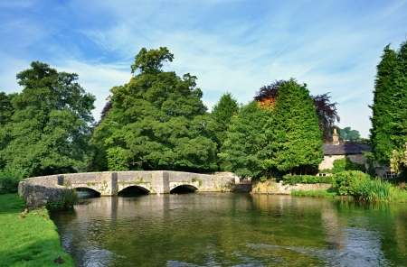 Sheepwash Bridge and the River Wye at Ashford-In-The-Water in Derbyshire,England Stock Photo - 23086306