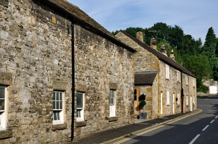 Traditional stone cottages at Ashford-On-The-Water, Derbyshire in the Peak District National Park Stock Photo - 23086311