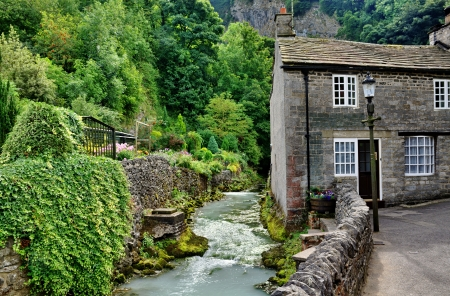 View of a stone built cottage by a river in the village of Castleton,Edale, in Stock Photo - 23860024