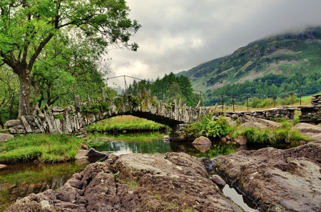 A stone built Packhorse bridge at Little Langdale in the English Lake District Stock Photo - 23862111