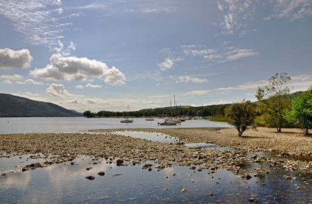 Boats moored on the shore of Coniston Water in the English Lake District, Cumbria Stock Photo - 23862929