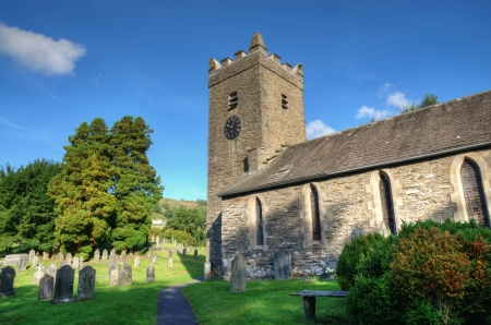 english countryside: Troutbeck Church and churchyard on a sunny day in the English Lake District