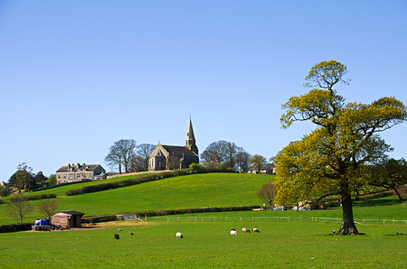 cumbria: View of Bardsea Church in with trees and green fields