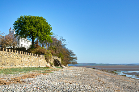 View of a white painted house overlooking the shore at Aldingham
