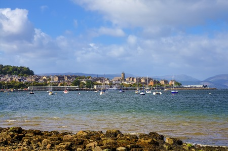 Scenic view of Gourock town and harbor viewed from the beach in Renfrewshire, Scotland.
