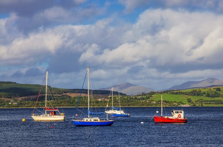 Boats in the Gourock bay on the river Clyde near Inverclyde, Scotland.