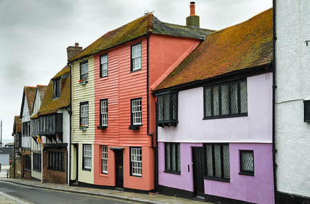 A street in the old town area of Hastings, East Sussex, England with traditional colourful painted house and cottages.