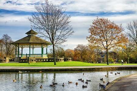 Bandstand and duck pond in picturesque Greenhead park, Huddersfield, Yorkshire, England