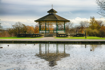 Bandstand and duck pond in scenic Greenhead Park, Huddersfield, Yorkshire, England.