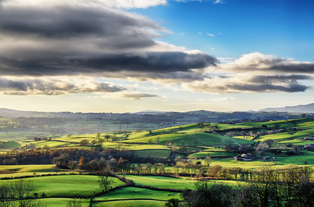 Remote rural English countryside in Cumbria, with rolling hills and isolated farmhouses.