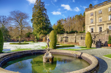 Ornamental fountain and garden of Rydal Hall on a frosty morning. Rydal Hall is a well known Christian retreat in the English Lake District. Editorial