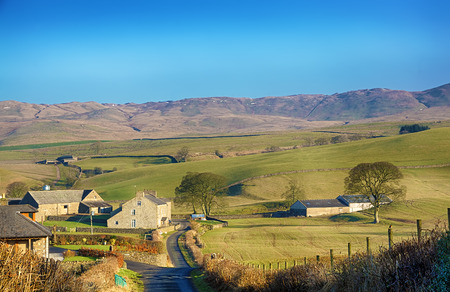fells: Typical English rolling rural countryside near the Cumbrian village of Grayrigg.