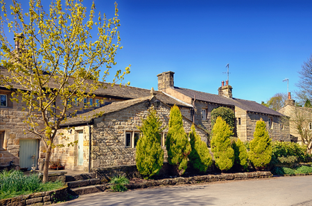 Row of stone cottages in the medieval Lancashire village of Wycoller, Northern England.