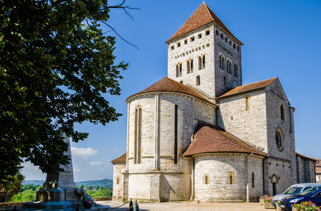 St Andrews church, A Romanesque church in the pretty medieval village of Sauveterre-de-Bearn in the Pyrenees-Atlantiques region of South West France. Stock Photo