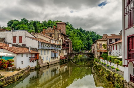 A view of the old bridge and river Nive in the picturesque Basque town of  Saint-Jean-Pied-de-Port, South western France.