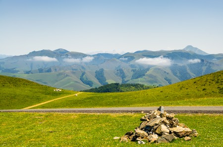Scenic Summer view of grazing meadows in the French pyrenees near Saint-Jean-Pied-de-Port.