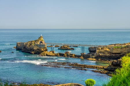 The Virgin Rock and bridge connecting to the shore in Biarritz, South West France. Stock Photo