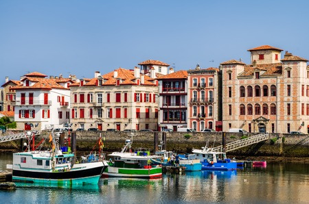 pays: The harbour and quayside in Saint-Jean-de-Luz, Pays Basque, South West France with fishing boats. Stock Photo