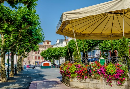 A bandstand surrounded by colourful flowers in the French town of Saint-Jean-de-Luz, Pays Basque.