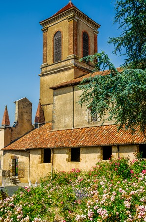 The church in La Bastide-Clairence, France, with Summer flowers.