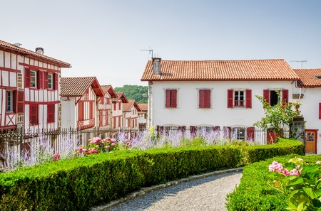 Traditional red and white Basque houses in the pretty French village of La Bastide-Clairence. Stock Photo