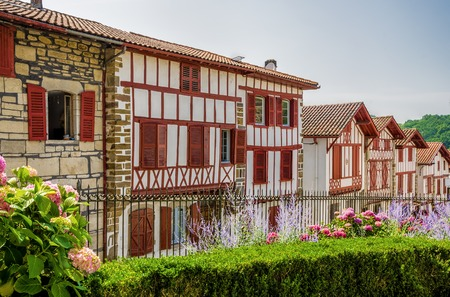 A Row of typical red and white Basque cottages in La Bastide-Clairence, South West France.