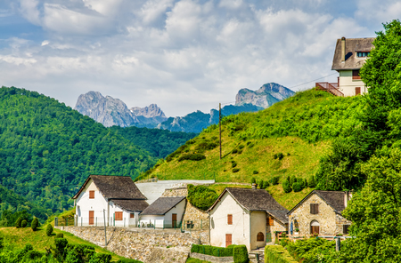 A view of the Beautiful village of Aydius in the French Pyrenees, with a backdrop of high mountains.