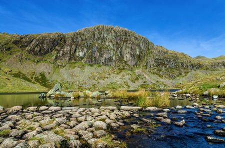 langdale pikes: A view of Stickle Tarn and Pavey Ark in the English Lake District.