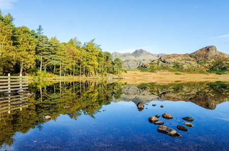 districts: Scenic view of Blea Tarn in the English Lake District, Cumbria, England. Stock Photo
