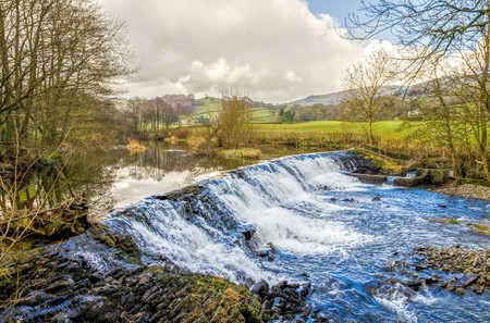 weir: Weir on River Kent at Staveley in Cumbria, England on sunny day.