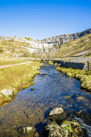 beck: Malham Beck and Cove in North Yorkshire, England. Stream feeds into the River Aire. Stock Photo