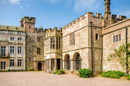 Courtyard outside Hutton in the Forest country estate in Skelton, Cumbria, England against blue skies on sunny day. Stock Photo